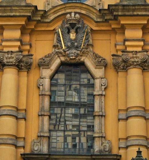 """Above the entrance is a relief of the Habsburg Eagle with the letter """"L"""", which reminds us of Emperor Leopold under whose reign the church was built"""